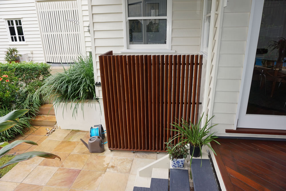 Timber feature cover to water tank